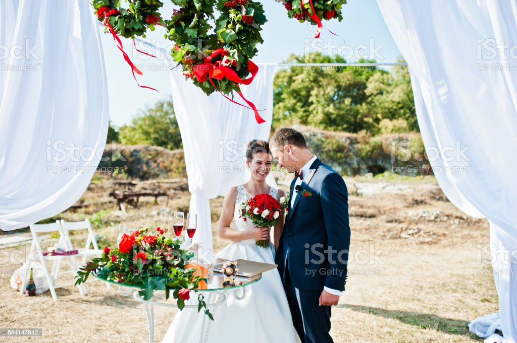 Newlyweds on wedding ceremony at sunny day stock photo