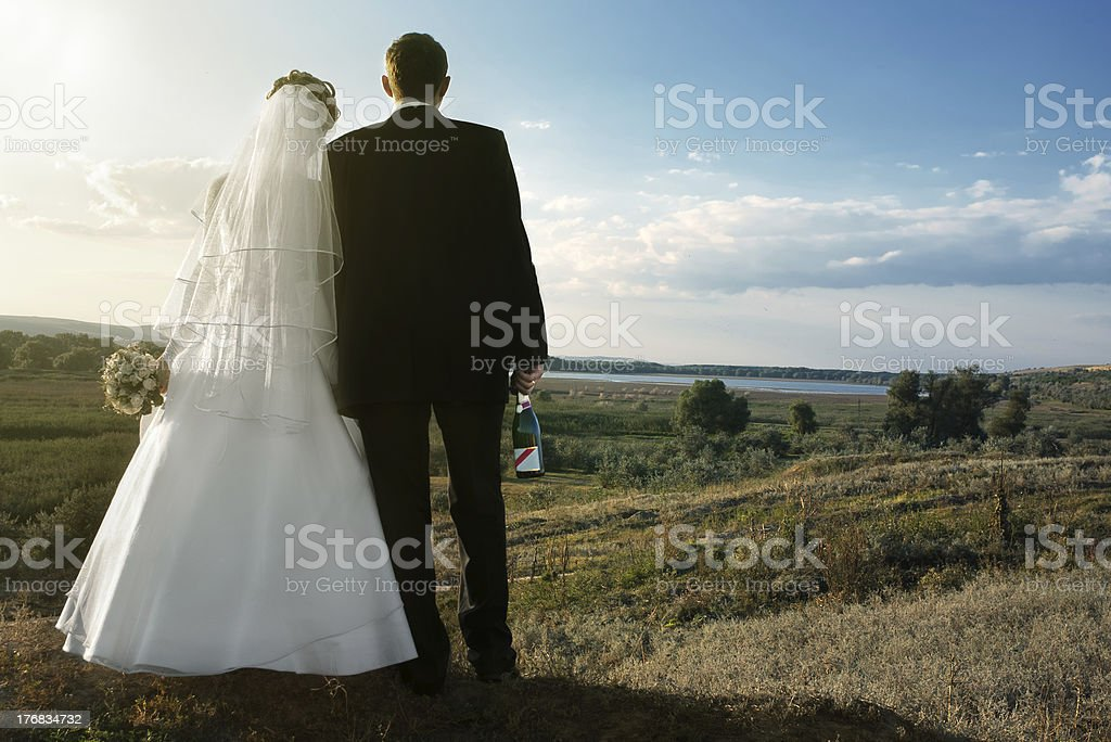 newlyweds outdoors in the morning royalty-free stock photo