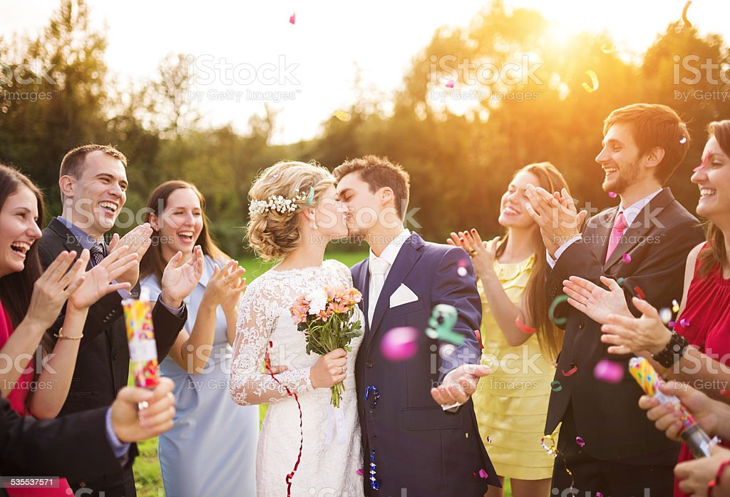 Newlyweds with guest on their garden party stock photo