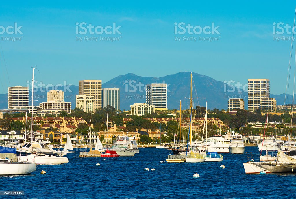 Newport Beach skyline, mountains, and harbor stock photo