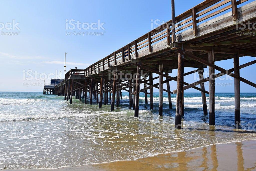 Newport Beach under the Pier stock photo