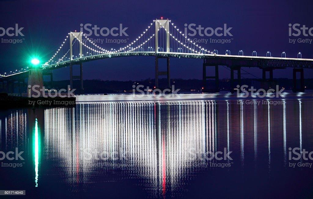 Newport Harbor Lighthouse and Bridge stock photo