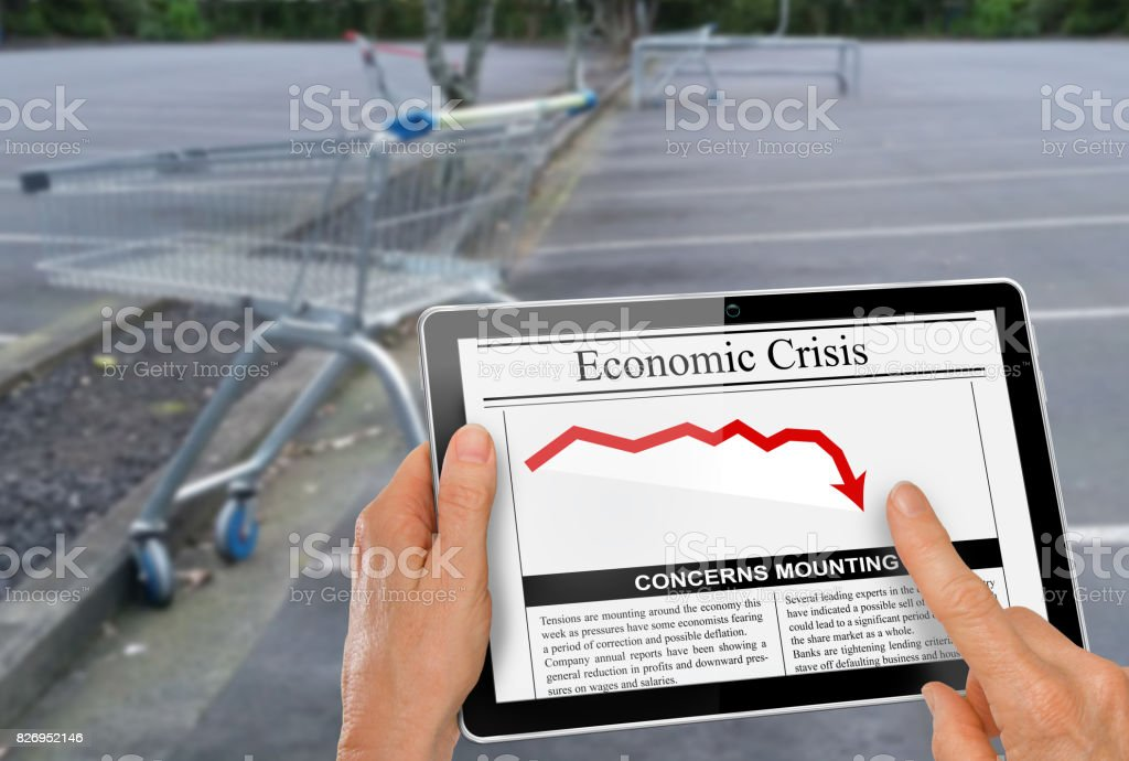 News about financial crisis reading with hand on a computer tablet stock photo