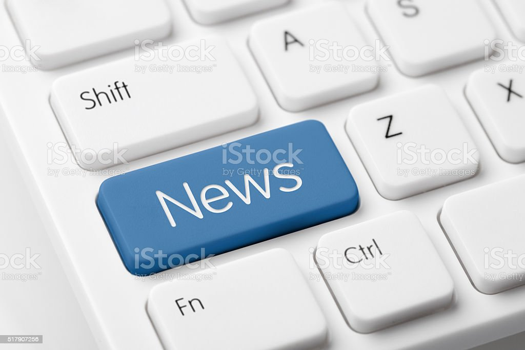 News button on white computer keyboard stock photo