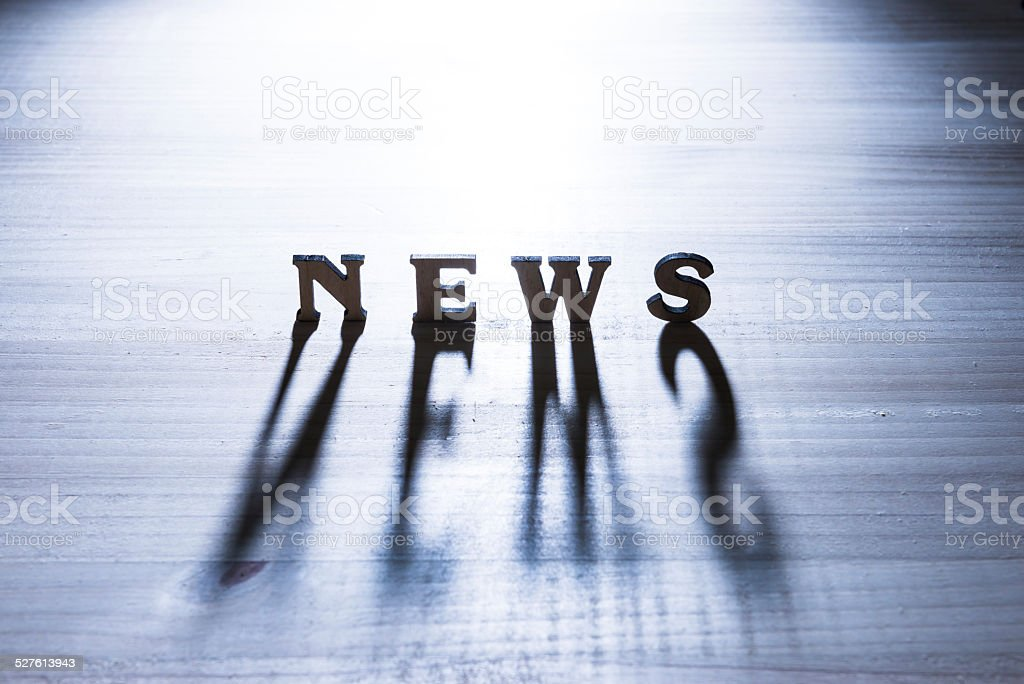 News concept and shadow stock photo