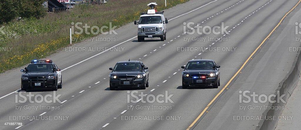 News Media Van Following Police Memorial Motorcade 6-6-13 stock photo