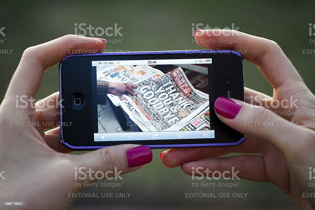 News of the world on iphone 4 stock photo