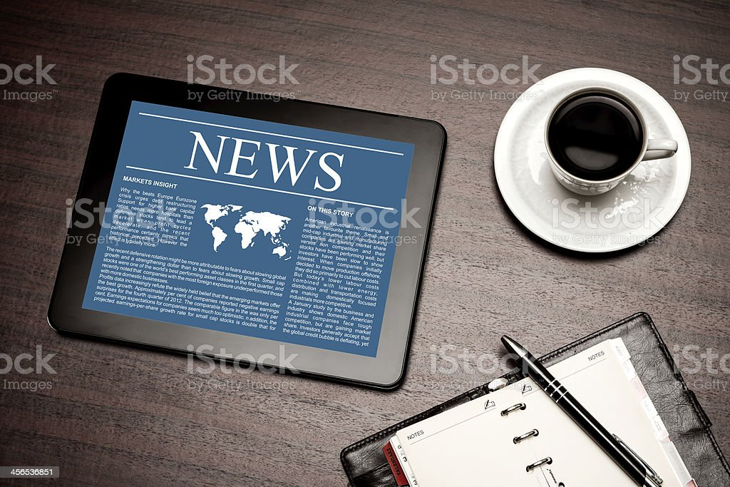 News on digital tablet. stock photo