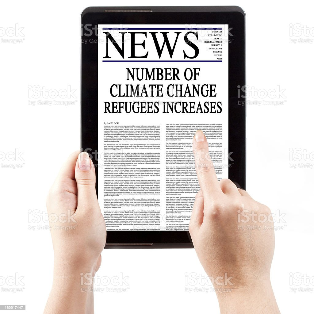 News on Tablet Computer - Climate Change Refugees royalty-free stock photo