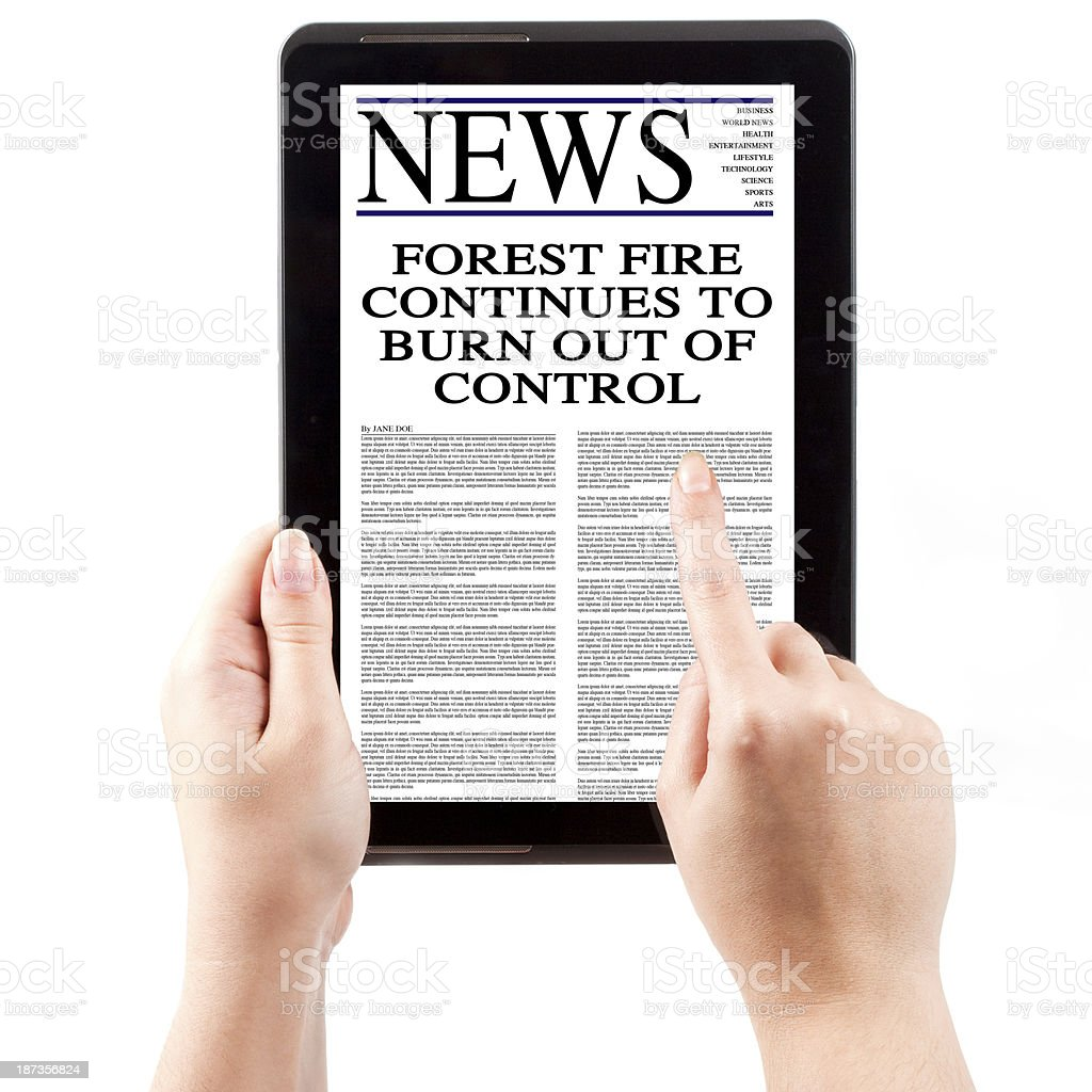 News on Tablet Computer - Forest Fire royalty-free stock photo