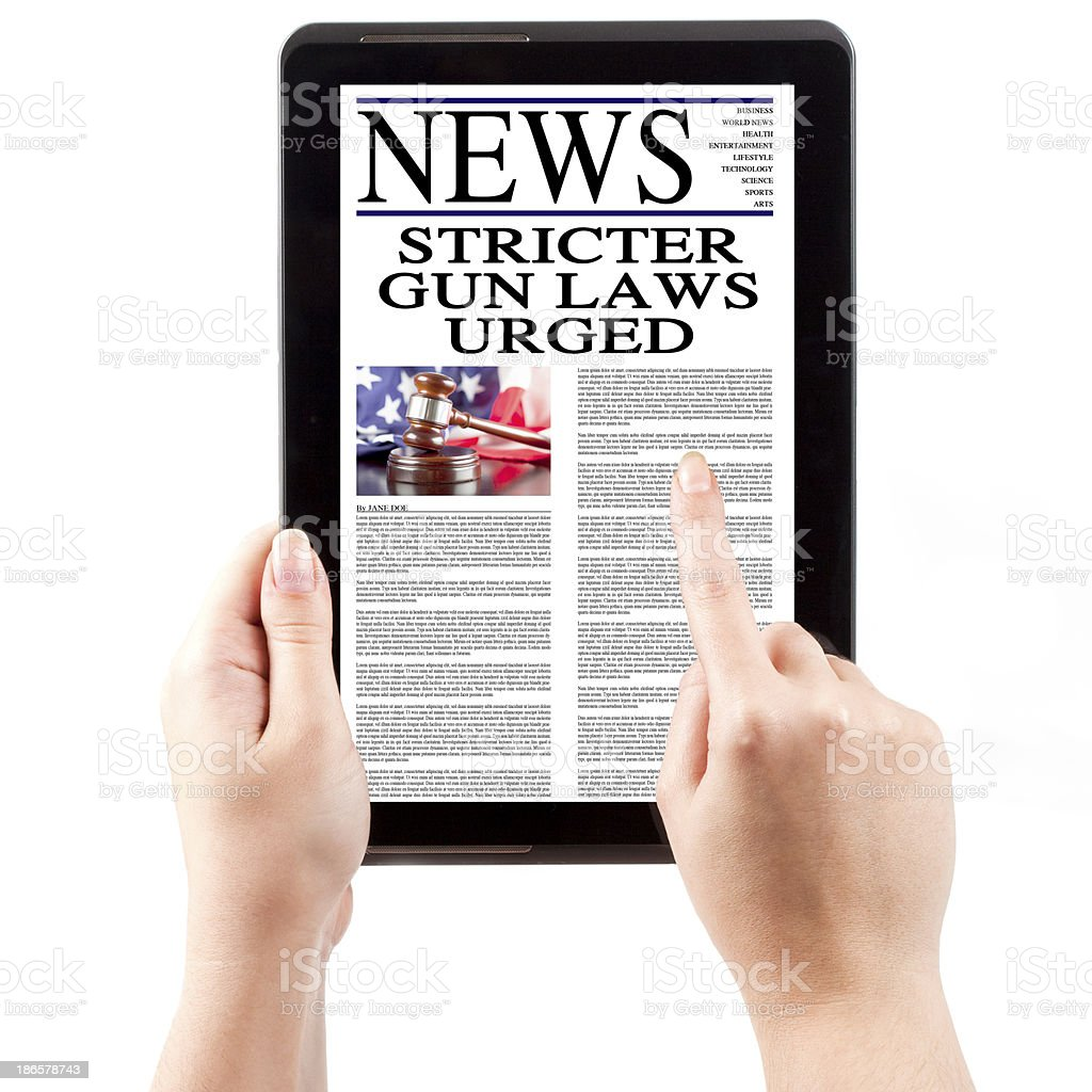 News on Tablet Computer - Gun Laws royalty-free stock photo