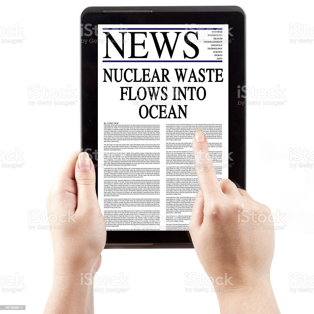 News on Tablet Computer - Nuclear Waste Contamination royalty-free stock photo