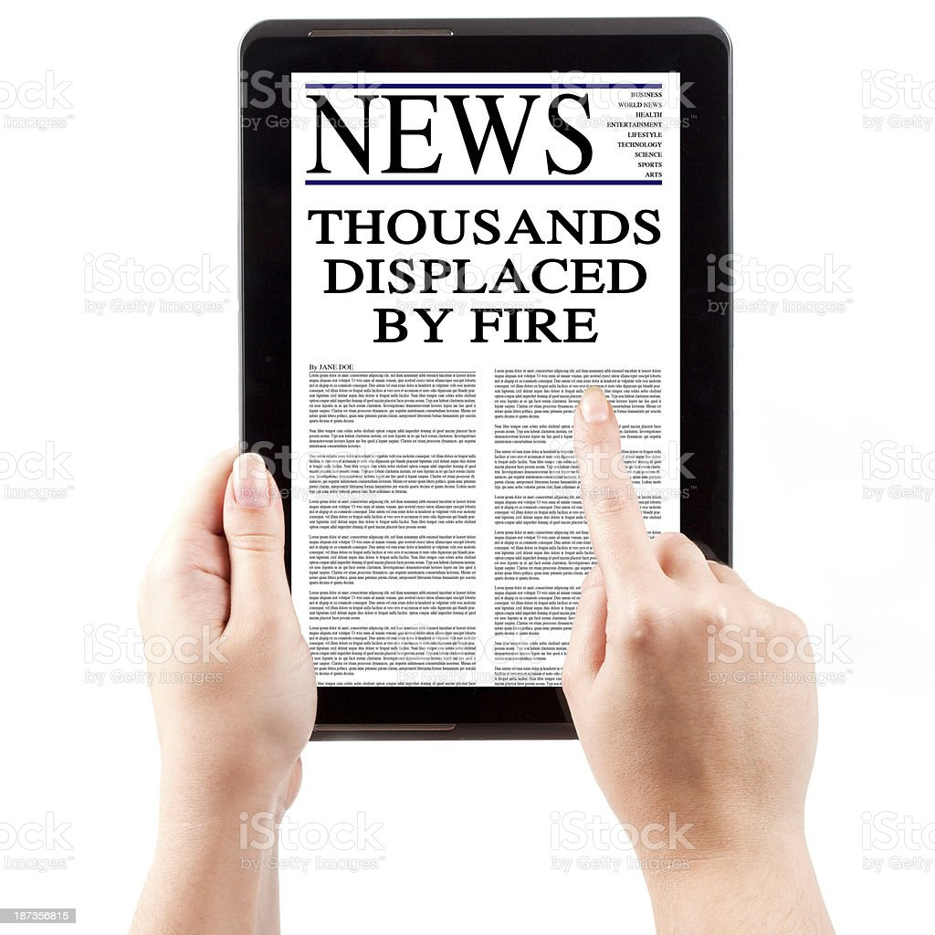 News on Tablet Computer - People Displaced by Fire royalty-free stock photo