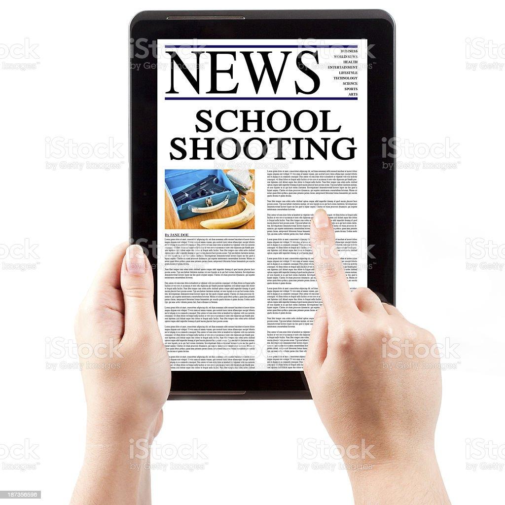 News on Tablet Computer - School Shooting stock photo
