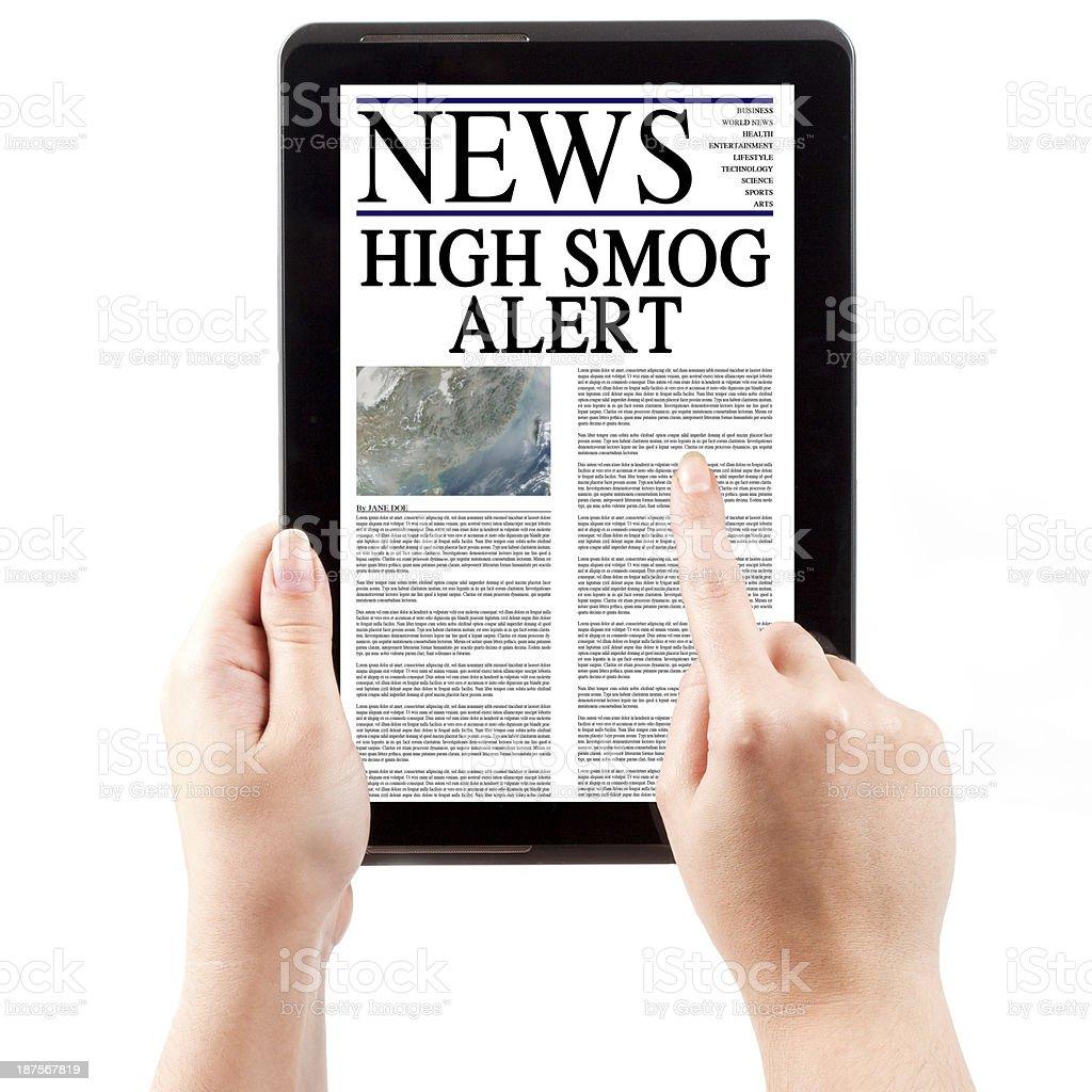 News on Tablet Computer - Smog Alert royalty-free stock photo