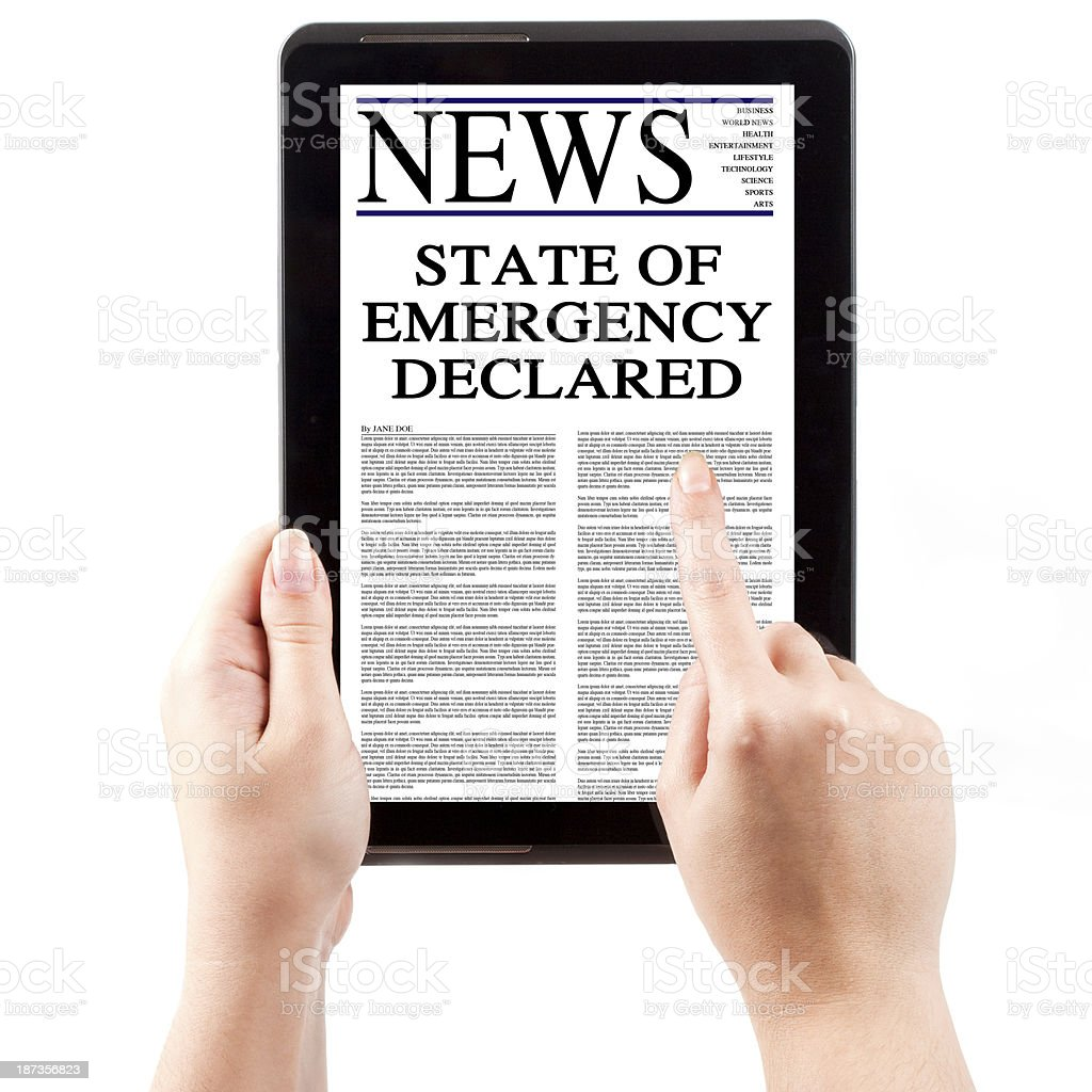 News on Tablet Computer - State of Emergency royalty-free stock photo