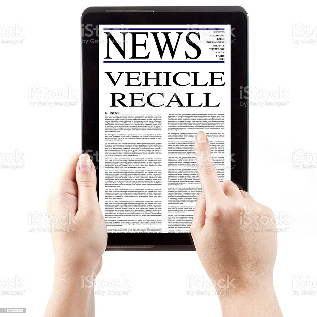 News on Tablet Computer - Vehicle Recall royalty-free stock photo