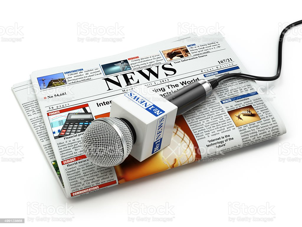 News or journalism concept. Microphone on the newspaper isolated stock photo