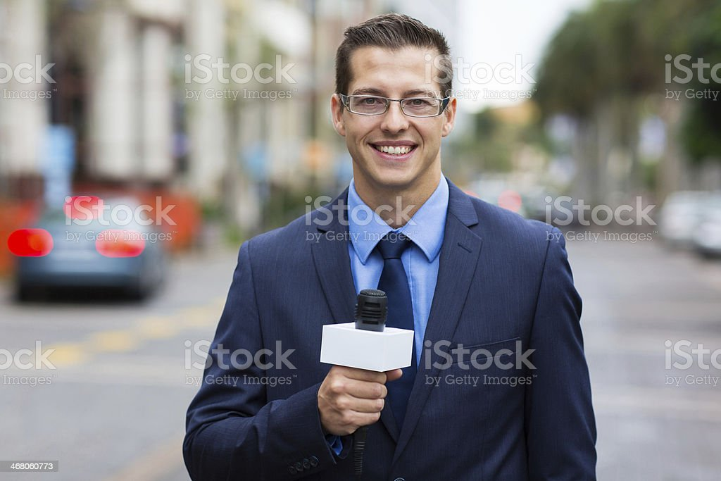 news reporter live broadcasting on street stock photo