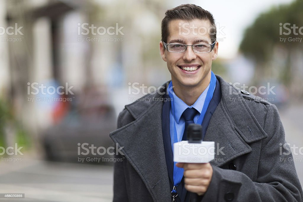news reporter working in a cold weather stock photo