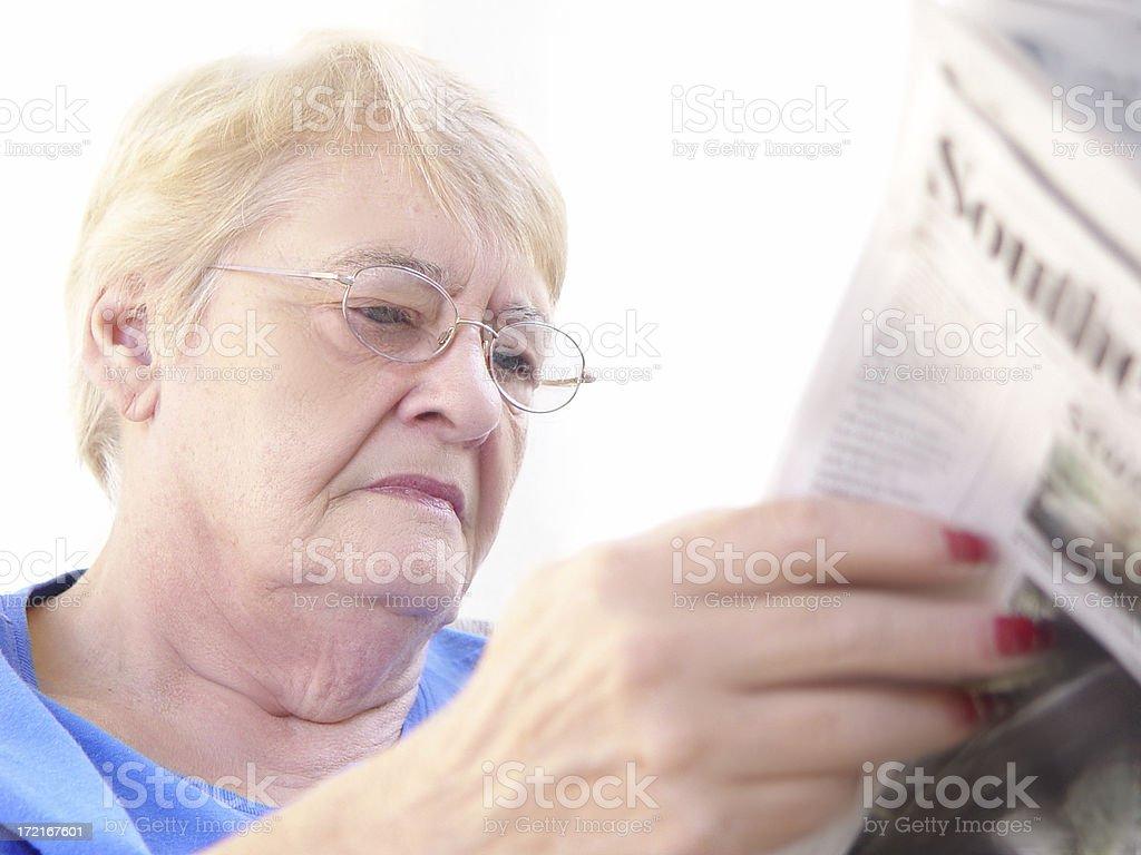 news series - reading newpaper stock photo