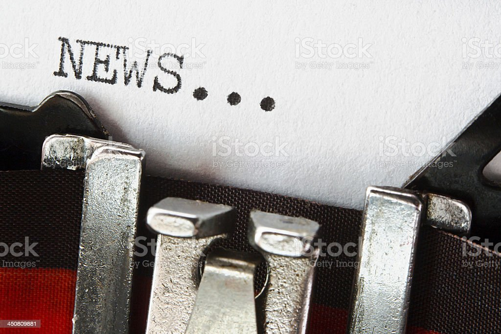 news text on retro typewriter stock photo