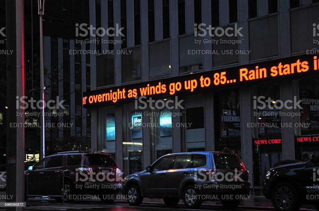 News ticker during storm updating status of Hurricane Sandy stock photo