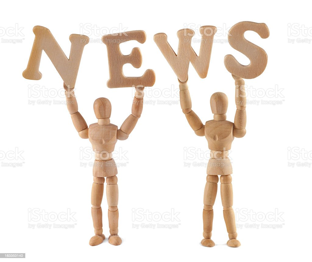 News - wooden mannequin holding this word stock photo