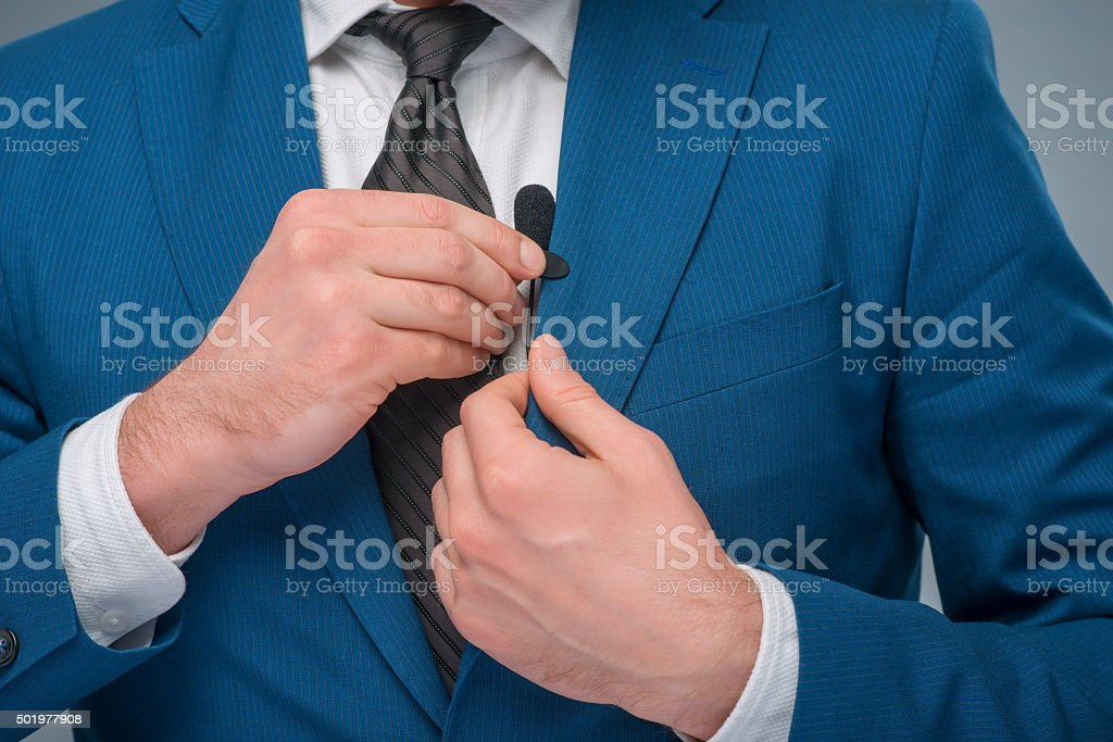 Newscaster adjusting the microphone stock photo