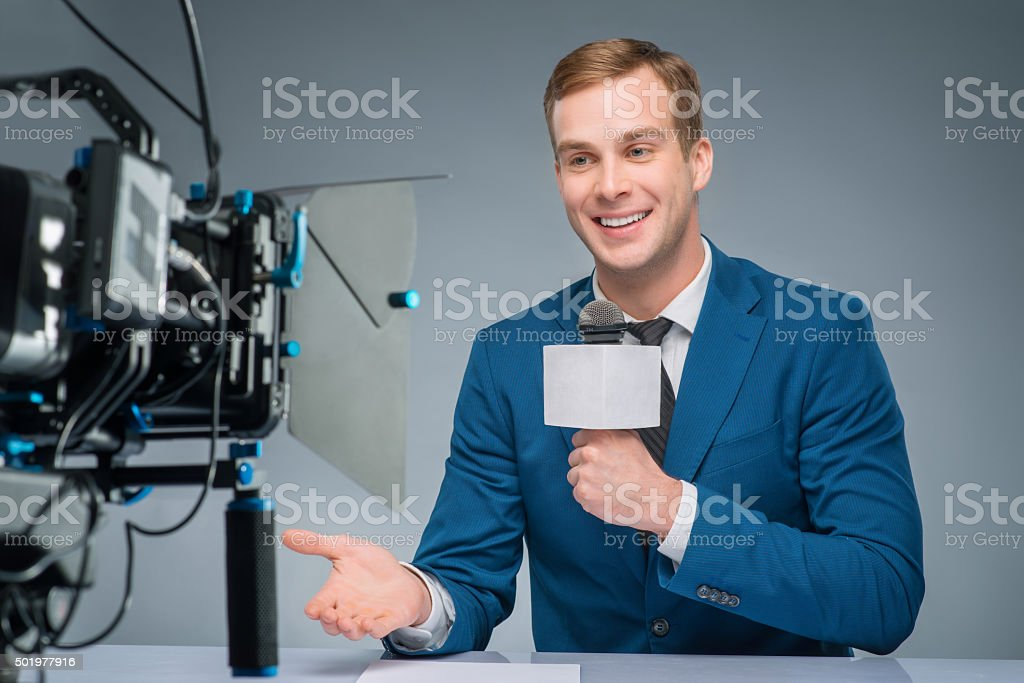 Newsman during broadcasting process stock photo