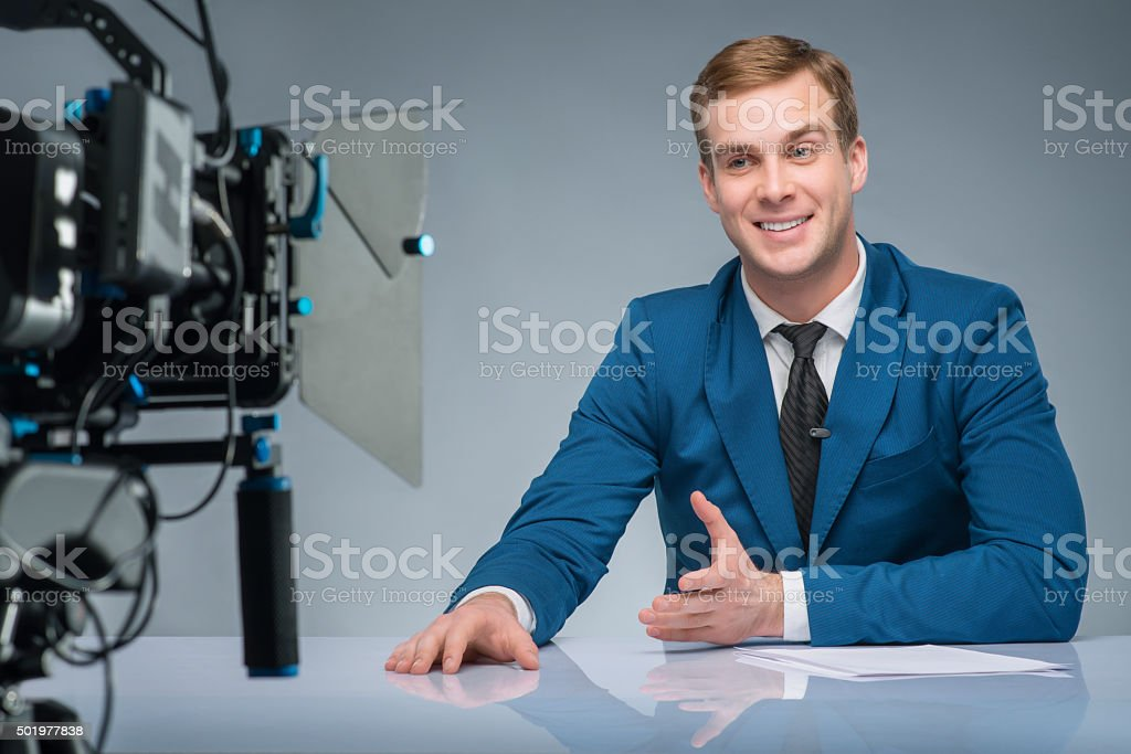 Newsman during shooting process stock photo