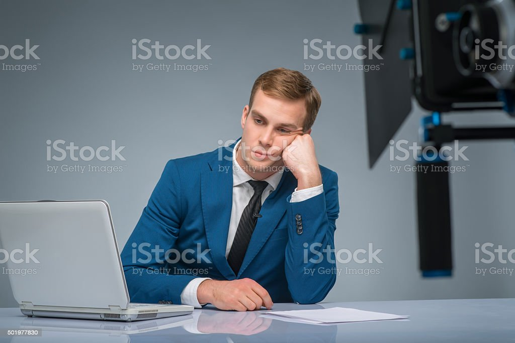 Newsman looking bored and weary stock photo