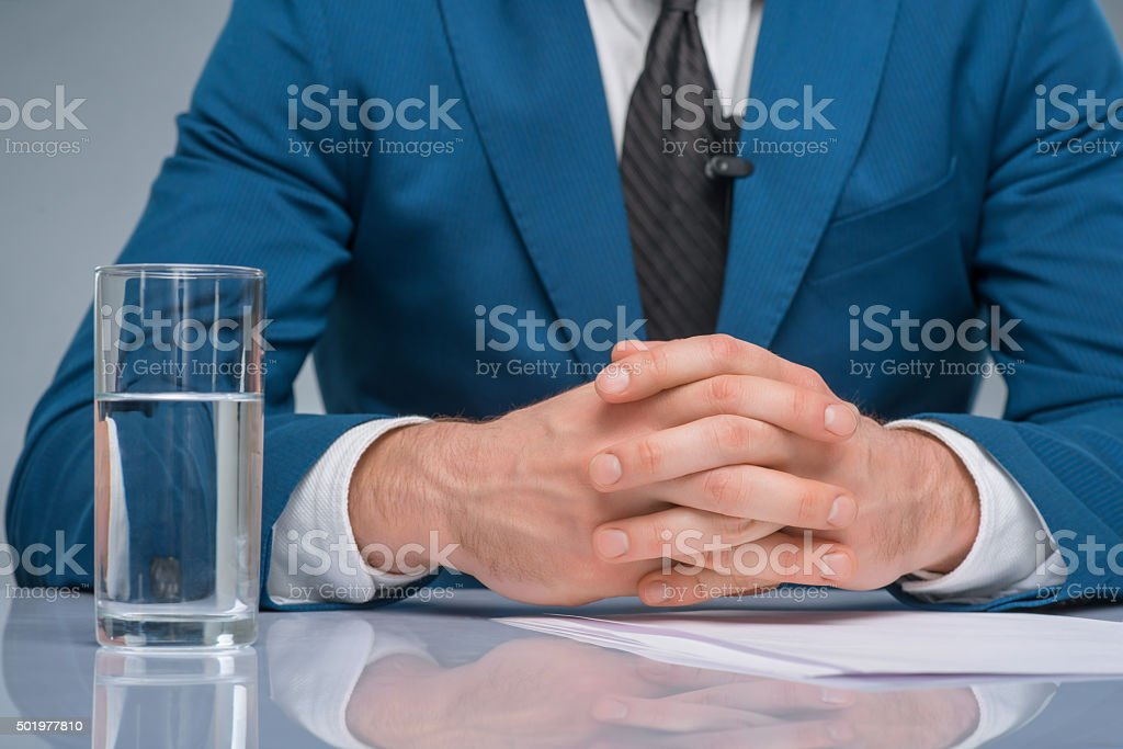 Newsman sitting at his workplace stock photo