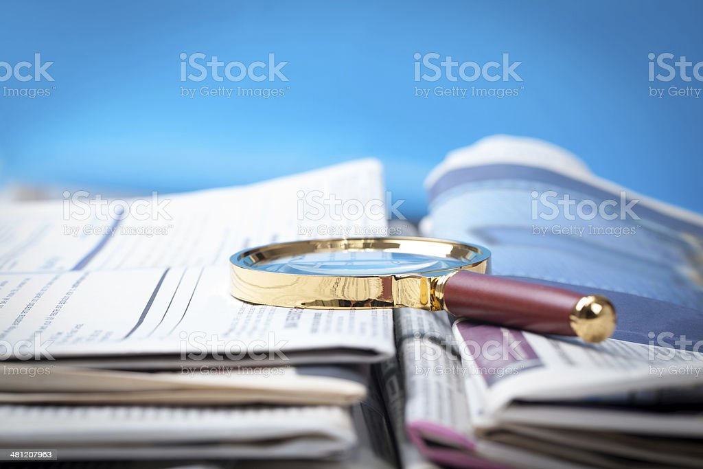 Newspaper and Magnifying Glass royalty-free stock photo