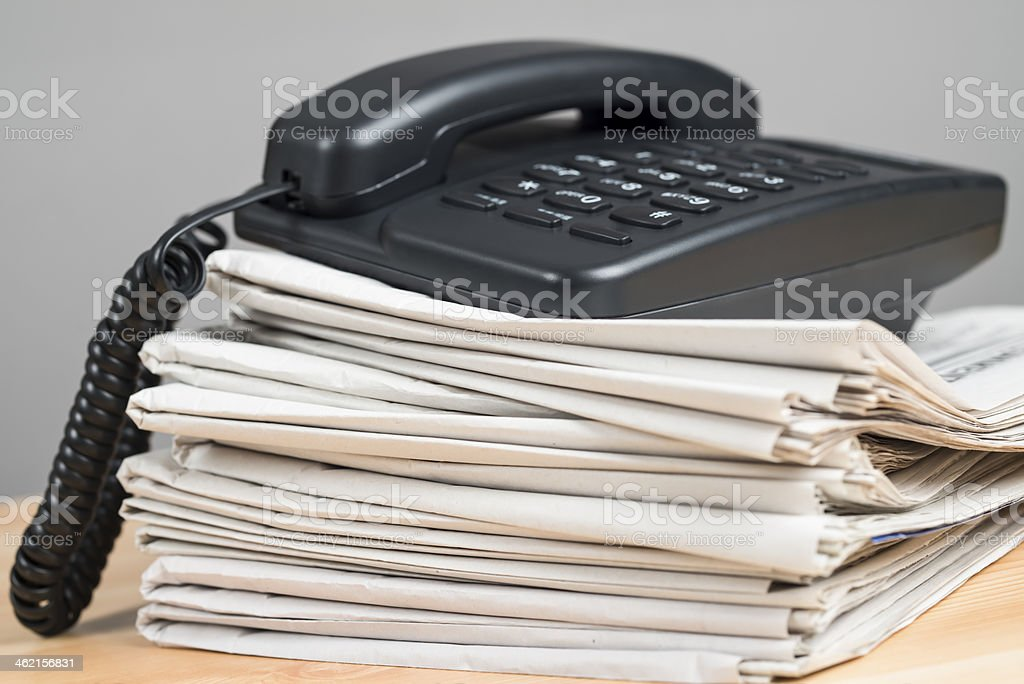 newspaper  and phone royalty-free stock photo