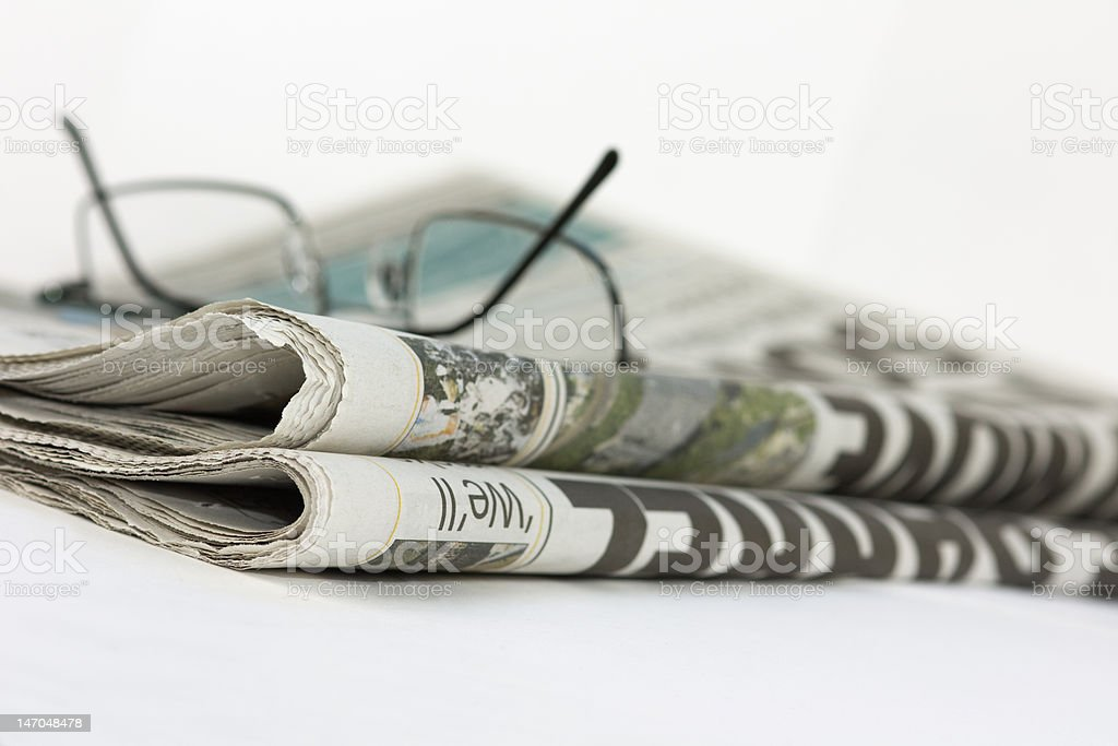 Newspaper and Spectacles royalty-free stock photo