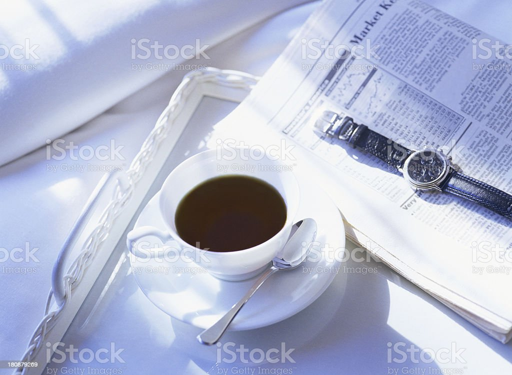 newspaper and wrist watch royalty-free stock photo