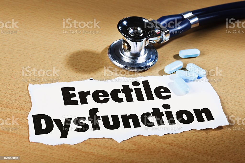"""Newspaper announcement: """"Erectile Dysfunction"""" with stethoscope and blue pills royalty-free stock photo"""