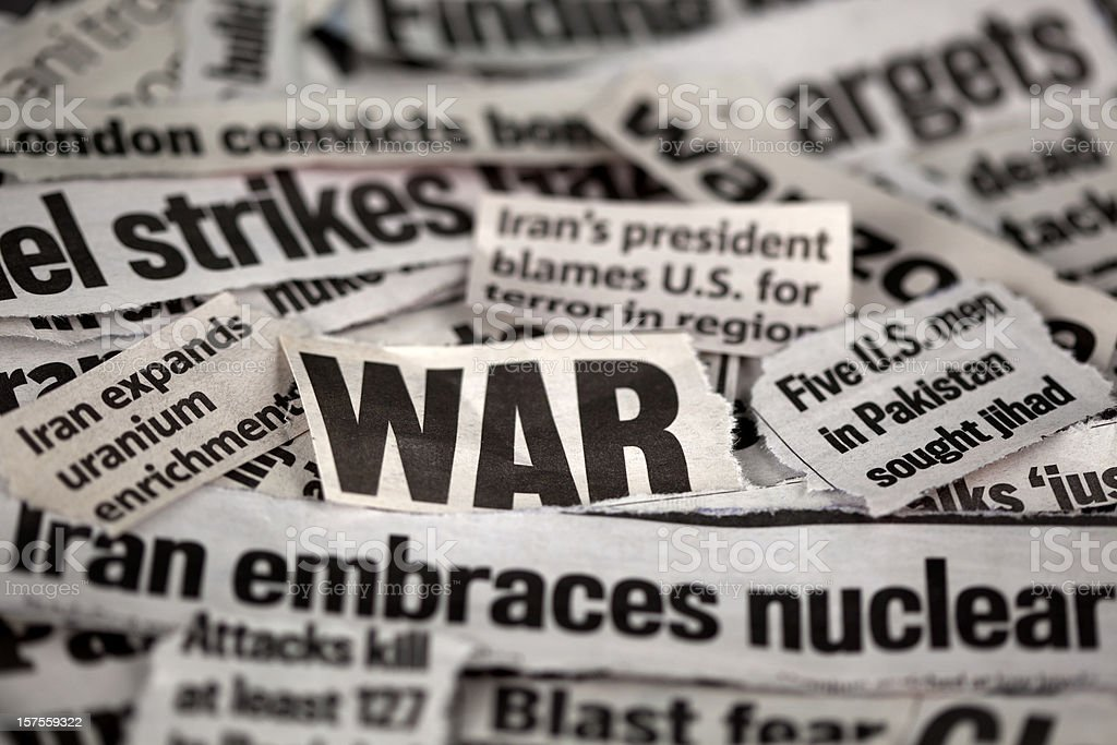 Newspaper cut outs with WAR related themes royalty-free stock photo