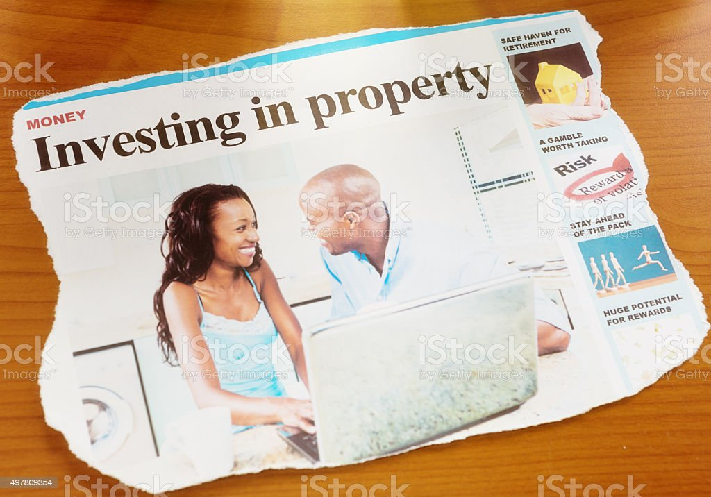 Newspaper cutting dealing with investment in property stock photo