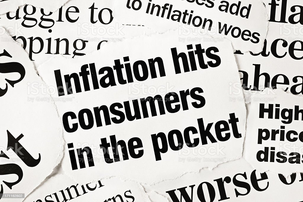 Newspaper headlines all concerned with inflation stock photo