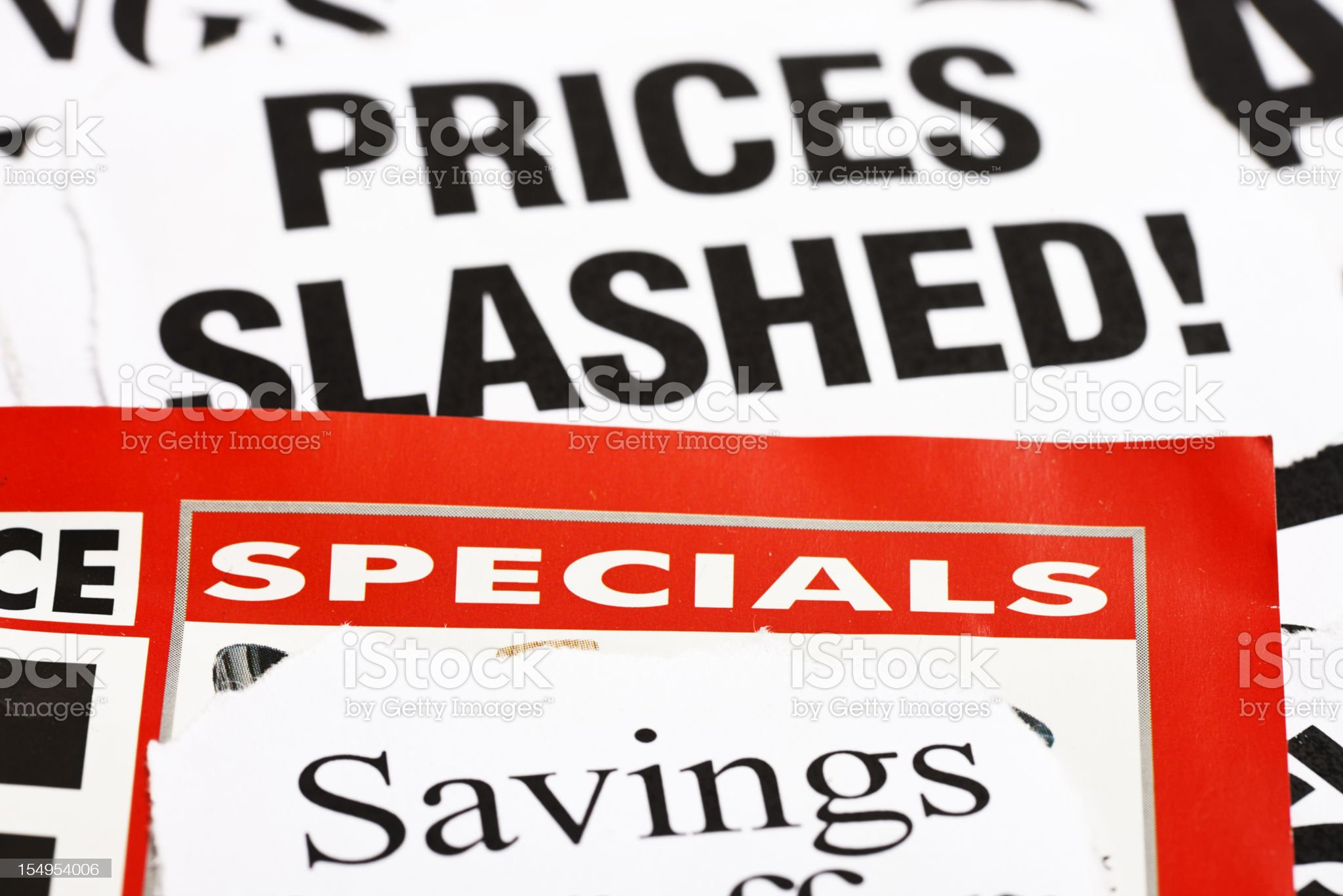 Newspaper headlines announce price cuts royalty-free stock photo