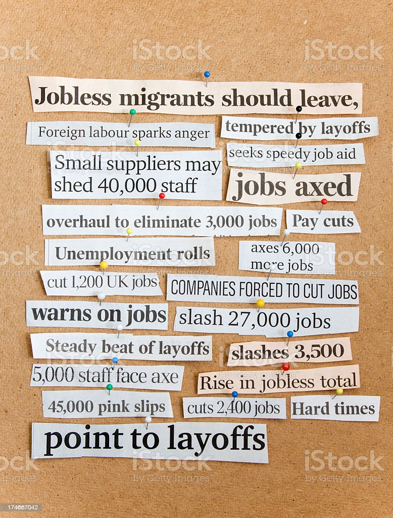 Newspaper headlines on corkboard. Job cuts, Unemployment. royalty-free stock photo