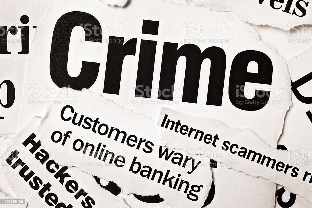 Newspaper headlines on crime, especially computer-related scames and hacking royalty-free stock photo