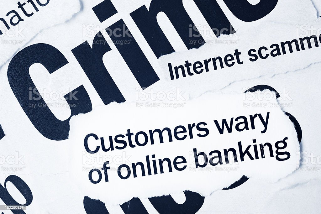 Newspaper headlines on crime, specifically online banking fraud royalty-free stock photo