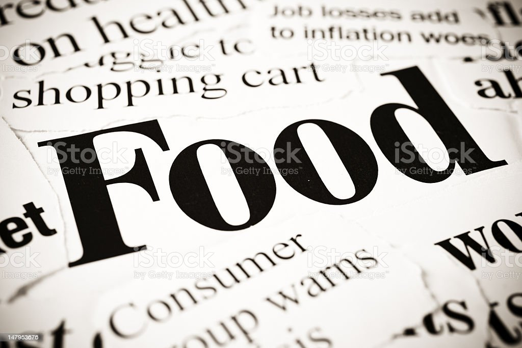 Newspaper headlines on food and inflation royalty-free stock photo