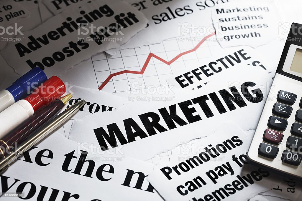 Newspaper headlines on marketing plus calculator and pens royalty-free stock photo