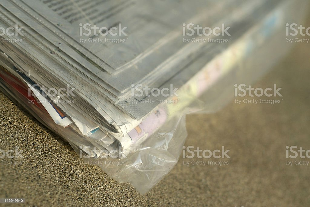 Newspaper in bag stock photo