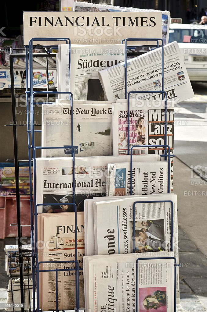 Newspaper in display Rack stock photo