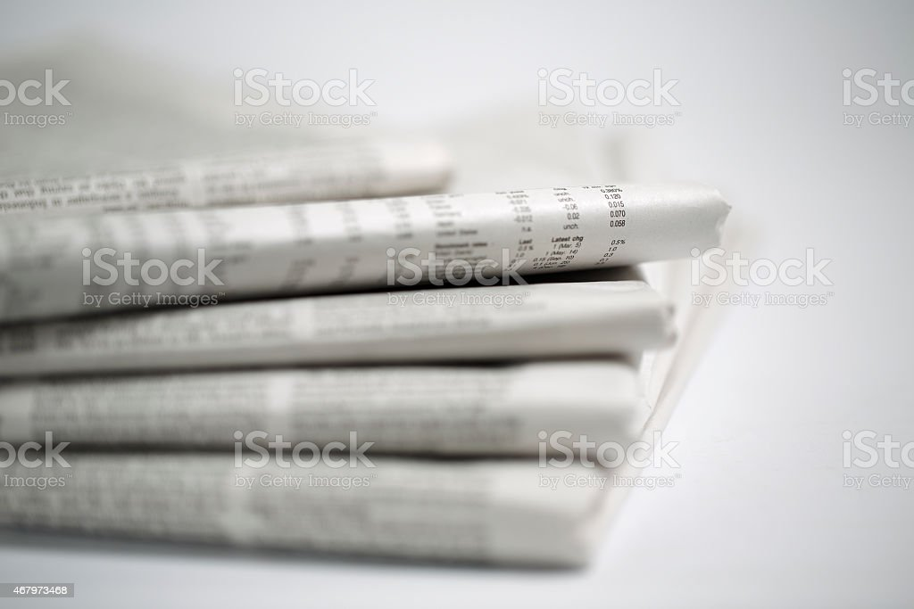 newspaper isolated on white background stock photo